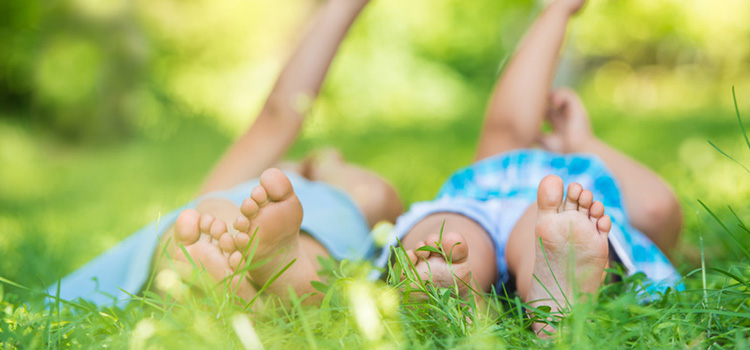 Photograph of children laying in the grass in South Pointe Gainesville, FL.